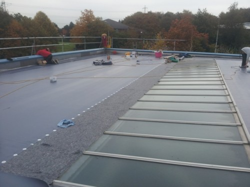 8. Trocal overliad in Duranite MX membrane on separation fleece. 500x375 Sika Trocal Roofing System Replacement