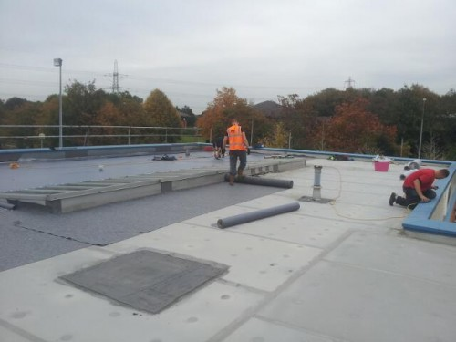 8. Trocal overliad in Duranite MX single ply membrane. 500x375 Sika Trocal Roofing System Replacement